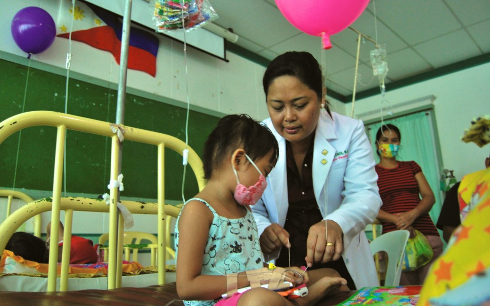 Dr. Dolendo, pictured here as she attends to a young patient