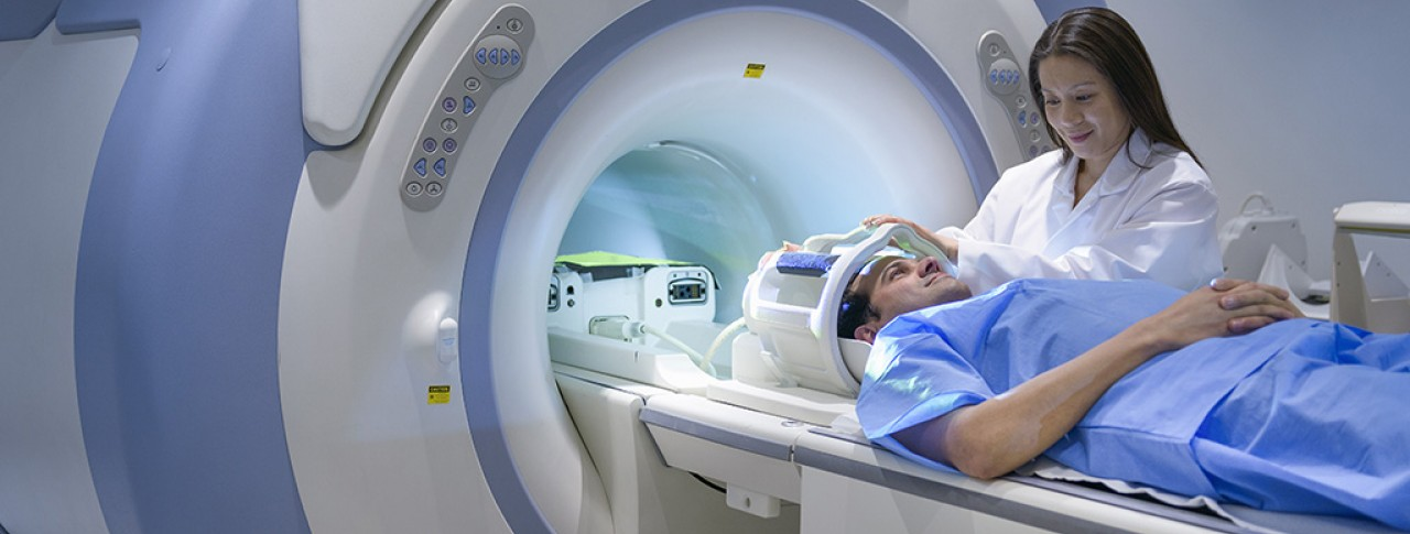 Doctor and patient using Magnetic Resonance Imaging (MRI) scanner
